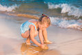 Adorable Little Girl Playing At The Seashore Stock Photo - 34159870