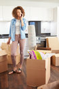 Woman Moving Into New Home Talking On Mobile Phone Royalty Free Stock Images - 34162589