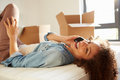 Woman Moving Into New Home Talking On Mobile Phone Stock Photos - 34163583