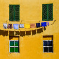 Detail Of Colorful Yellow House Walls, Windows And Clothes Royalty Free Stock Photography - 34166117