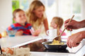 Close Up Of Father Preparing Family Breakfast In Kitchen Royalty Free Stock Images - 34169769