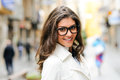 Beautiful Woman With Eye Glasses Smiling In Urban Background Stock Image - 34205971