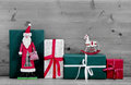 Christmas Presents And Gift Boxes With Santa On Grey Wooden Back Stock Image - 34221311