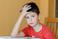 Tired And Bored Boy Doing School Homework Stock Photography - 34236742