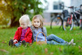 Two Little Sisters Playing Outside Royalty Free Stock Photos - 34238958