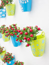 Plastic Flowers With Colorful Plastic Vase. Stock Image - 34242191