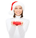 Smiling Woman In Santa Hat With Small Gift Box Royalty Free Stock Photography - 34245367