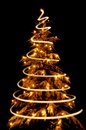 Christmas Tree With Light Spiral Drawn Around It Stock Photography - 34258702