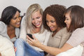 Interracial Group Beautiful Women Friends Using Smartphone Stock Images - 34301604