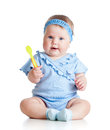 Baby Girl With A Spoon Stock Image - 34310231