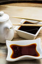 Soy Sauce In A White Dish And Chopsticks Stock Image - 34310441