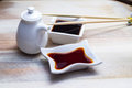 Soy Sauce In A White Dish And Chopsticks Stock Photography - 34310452