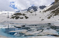 Melting Glacier And The Lake Of Clear Blue Water At An Altitude Of 2400 Meters In The Alps Royalty Free Stock Image - 34317446