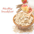 Oat Flakes In A Bowl And Apples In The Background, Isolated Royalty Free Stock Photography - 34319407