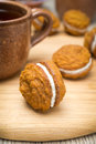 Pumpkin Cookies With Cream Filling And Cup Of Tea Stock Photography - 34319482