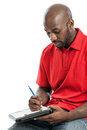 Casual Businessman Writing On A Clipboard Stock Photography - 34347712