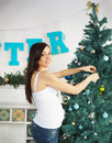 Happy Pregnant Woman Near The Christmas Tree Stock Images - 34351534