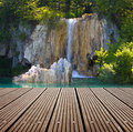 Waterfall And Empty Wooden Deck Table. Royalty Free Stock Images - 34383589