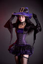 Smiling Witch In Purple And Black Gothic Halloween Costume Royalty Free Stock Photo - 34389415