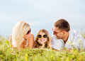 Happy Family With Blue Sky And Green Grass Stock Photo - 34391020