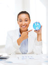 Attractive Businesswoman Pointing At Clock Royalty Free Stock Photo - 34394235