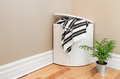 Laundry Basket And Plant In The Room Corner Royalty Free Stock Photos - 34398578