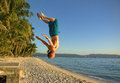 Athletic Man Doing A Somersault On A Beach Royalty Free Stock Images - 34417609