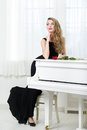 Full Length Of Woman Standing Near The Piano Stock Photos - 34419173