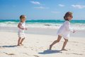 Two Little Sisters In White Clothes Have Fun At Stock Images - 34431354