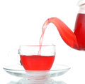 Tea Being Poured Into Glass Tea Cup Isolated Stock Photo - 34453660