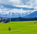 German Idyllic Pastoral Countryside In Spring With Alps In Backg Royalty Free Stock Photo - 34468165