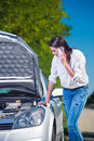 Beautiful Woman With Car Trouble Talking Over Phone Royalty Free Stock Image - 34470876