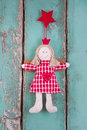 Sewn Angel Doll Hanging On Turquoise Wood Board - Christmas Stock Photos - 34489213