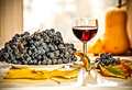Glass Of Wine And Grapes Royalty Free Stock Photography - 34495297