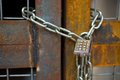 Lock With Chain On Rusty Gate Stock Image - 34506311