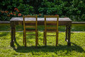 Empty Wooden Table With Garden And Two Chairs For Food. Outdoor Royalty Free Stock Photography - 34506487