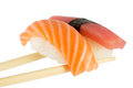 Isolated Salmon And Tuna Nigiri On Chopsticks And White Background Stock Images - 34516294