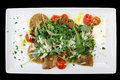 Rabbit Ravioli With Rocket Salad Isolated On Black Royalty Free Stock Photography - 34546707