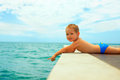 Curious Baby Boy Pointing Finger In Sea Water Royalty Free Stock Image - 34553786
