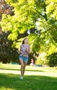 Happy Girl Running In Park Royalty Free Stock Photo - 34554085