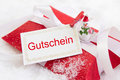 Close Up Of Red Christmas Present Box With German Text Royalty Free Stock Photo - 34558225