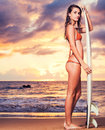 Surfer Girl On The Beach At Sunset Stock Photo - 34597700