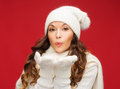 Happy Woman In Winter Clothes Blowing On Palms Stock Image - 34600831