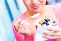 Happy Young Pretty Mixed Race Female Eating Frozen Yogurt Royalty Free Stock Photography - 34608767