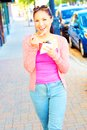 Happy Young Pretty Mixed Race Female Eating Frozen Yogurt Royalty Free Stock Images - 34608809