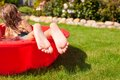 Close-up Of A Little Girl S Legs In Small Red Pool Royalty Free Stock Photo - 34635245