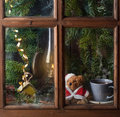 Christmas Decoration With Teddy Bear In Window Stock Image - 34647231