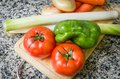 Fresh Vegetables On Cutting Board In The Kitchen Stock Photos - 34658553