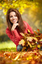Young Woman With Autumn Leaves Royalty Free Stock Photography - 34682327