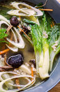 Pak Choy And Tea Tree Mushrooms Soup Stock Photo - 34717740